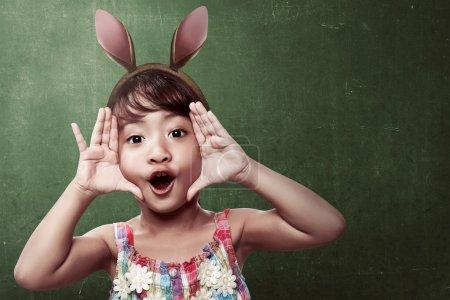 little girl wearing bunny ears