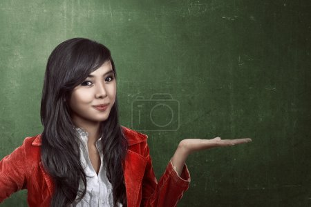 Woman show something with chalkboard background