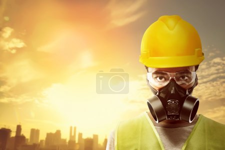 Asian worker wearing helmet and respirator.