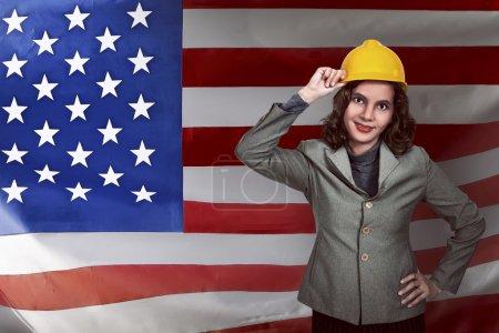 Asian businesswoman wearing yellow helmet