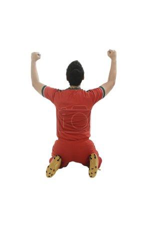 Winning football player after scoring