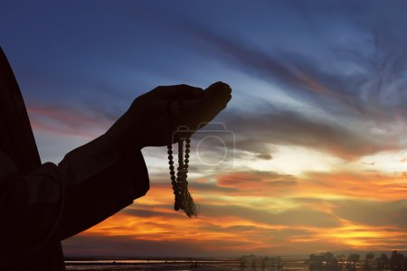 Photo for Image of silhouette hands of man praying with sunset background - Royalty Free Image