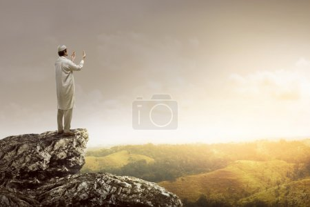 man standing on the top of cliff