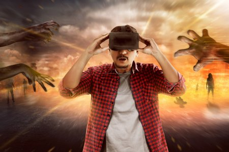 Photo for Young asian man wearing VR headset get into virtual reality world - Royalty Free Image