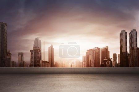 rising sun shining on buildings