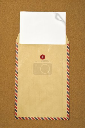 Photo for Brown envelope on brown background. Put your design on the paper - Royalty Free Image