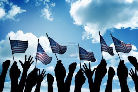 Group of people waving small USA flag