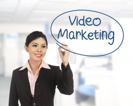 Asian business woman writing video marketing