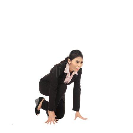 Asian business woman running