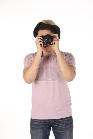Asian photographer taking image
