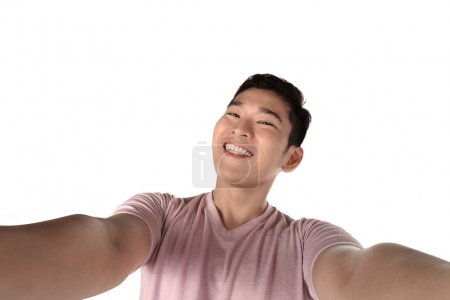man holding camera and making selfie