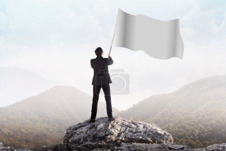 Successful man waving blank flag