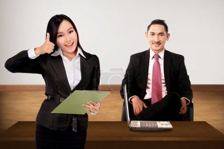 Boss and secretary posing