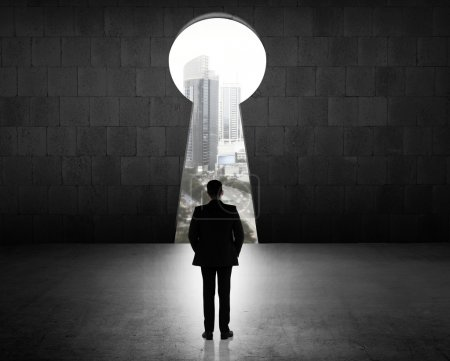 Business Man Looking Through Key Hole