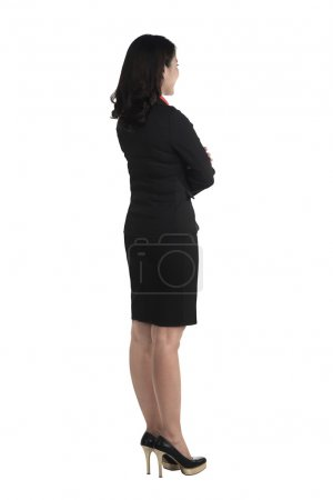 Asian business woman standing side view
