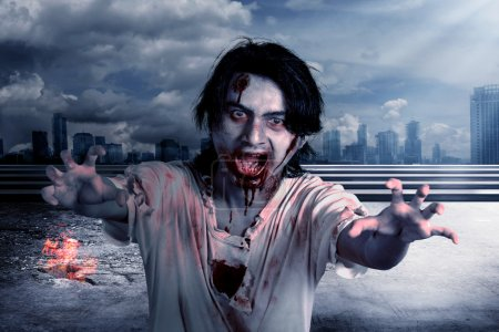 Creepy male zombie in the city