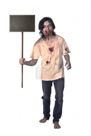 Creepy male zombie holding wooden board