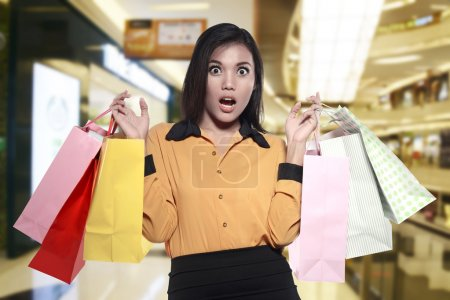 Asian woman holding shopping bags
