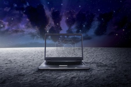 Big laptop on the outer space