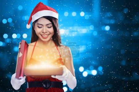 Santa Woman Opening Gift Box