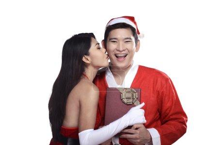 Woman give kiss to santa claus