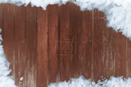 Snow and wooden board