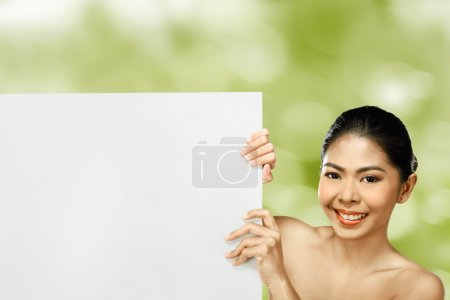 asian woman holding blank banner