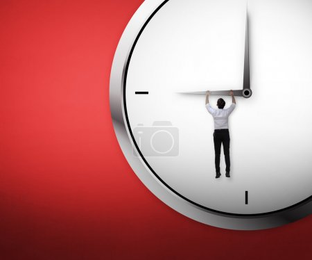 businessman hanging on the clock