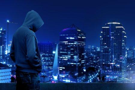 Computer hacker standing on the rooftop