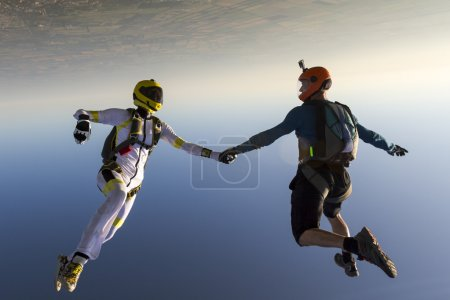 Boy and girl parachutist in free style.