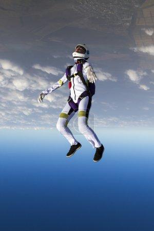 Parachutist in the head-down position.
