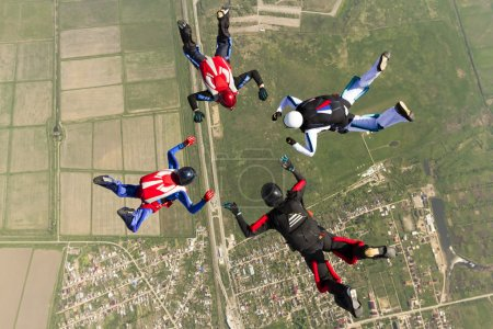 Sport  parachutists  build a figure in free fall.