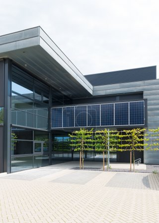 Photo for Solar panels above the entrance of a modern office building in Oldenzaal, Netherlands - Royalty Free Image
