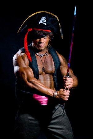 Portrait of a muscular man in a pirate costume