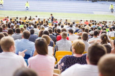 Spectators sit in the stadium