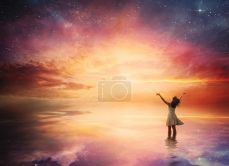 Photo for Woman stands in praise before a beautiful night sky. - Royalty Free Image