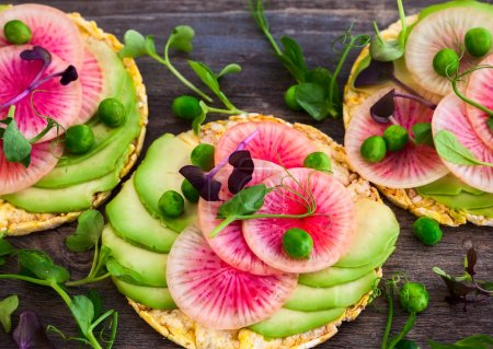Photo for Organic quinoa cakes with avocado and watermelon radish for breakfast - Royalty Free Image
