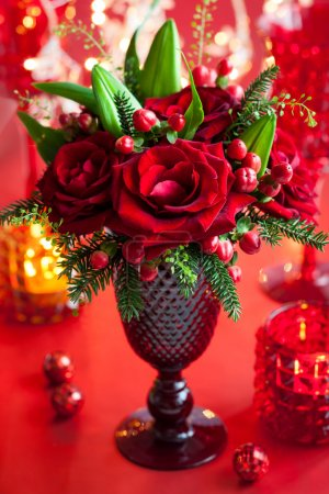 Photo for Christmas table decoration with flowers and candles - Royalty Free Image