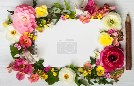 Flowers and notepad with copy space