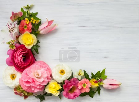 Photo for Flowers frame on white wooden background. Top view with copy space - Royalty Free Image
