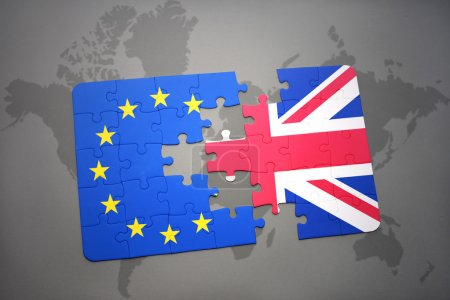 puzzle with the national flag of great britain and european union on a world map background. brexit concept