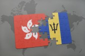puzzle with the national flag of hong kong and barbados on a world map background.