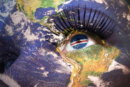 womans face with planet Earth texture and cape verde flag inside the eye.