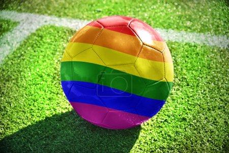 football ball with rainbow flag on the field