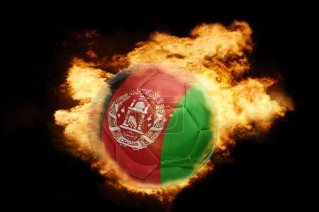 football ball with the flag of afghanistan on fire