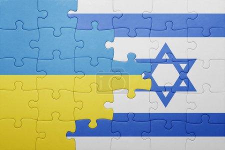 Foto de Rompecabezas con la bandera nacional de israel y Ucrania. concepto - Imagen libre de derechos