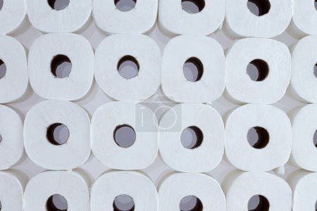 Background pattern of white toilet paper rolls