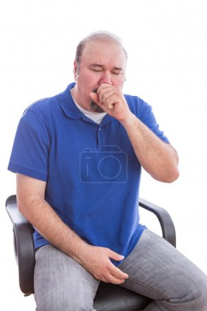 Sick Man Sitting on a Chair Suffering From Cough