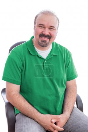 Bearded Middle Age Man Smiling on his Chair