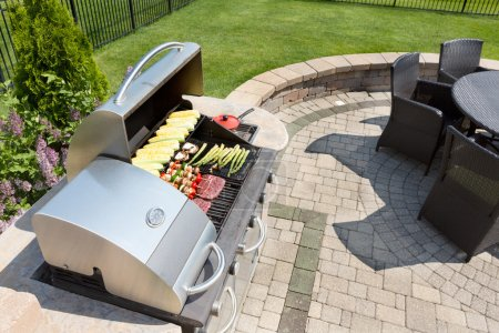 Grilling food on an outdoor gas barbecue